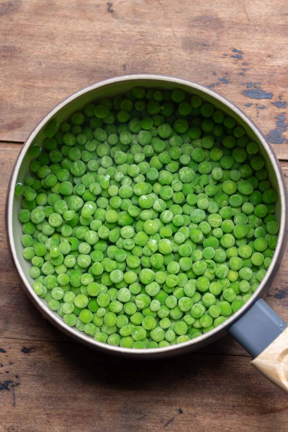 Peas boiling in a pot.