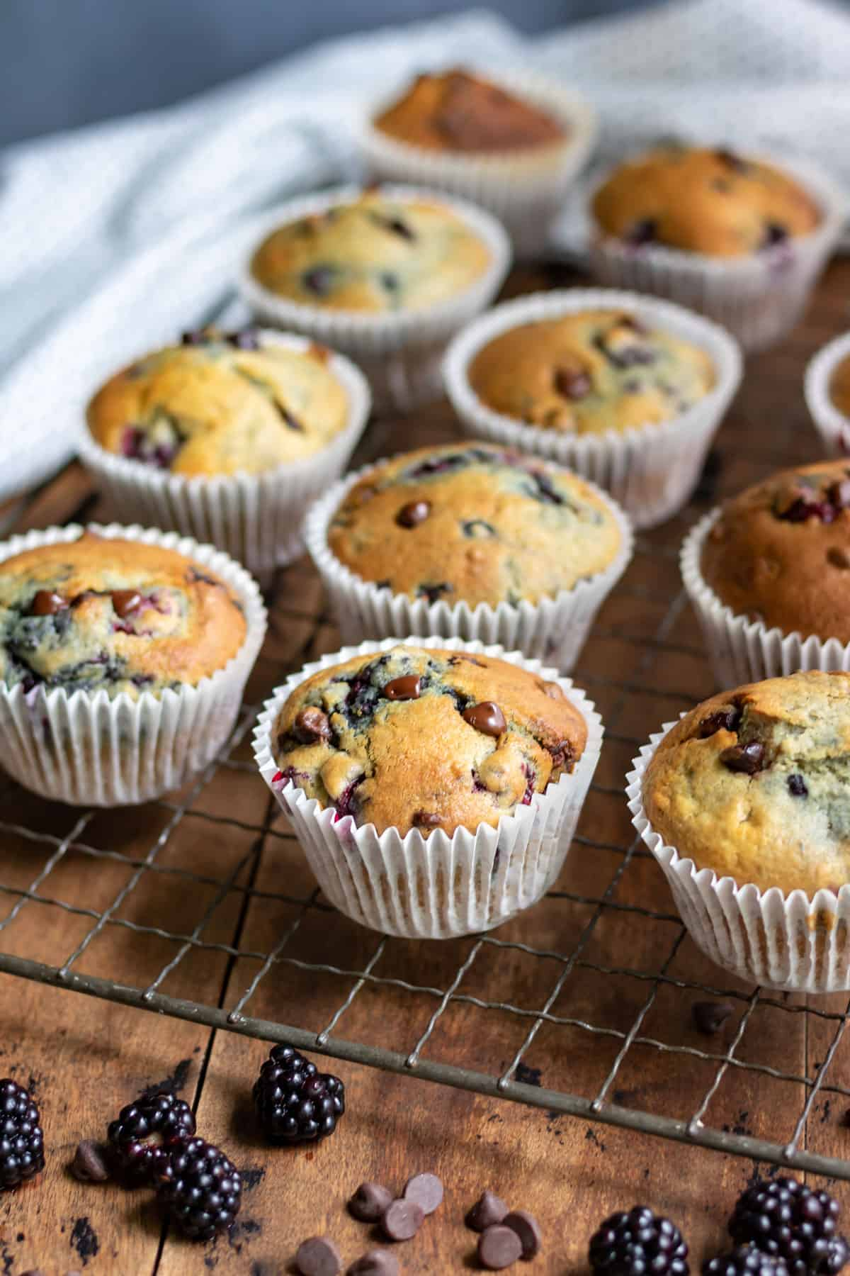 Muffins cooling on a rack.