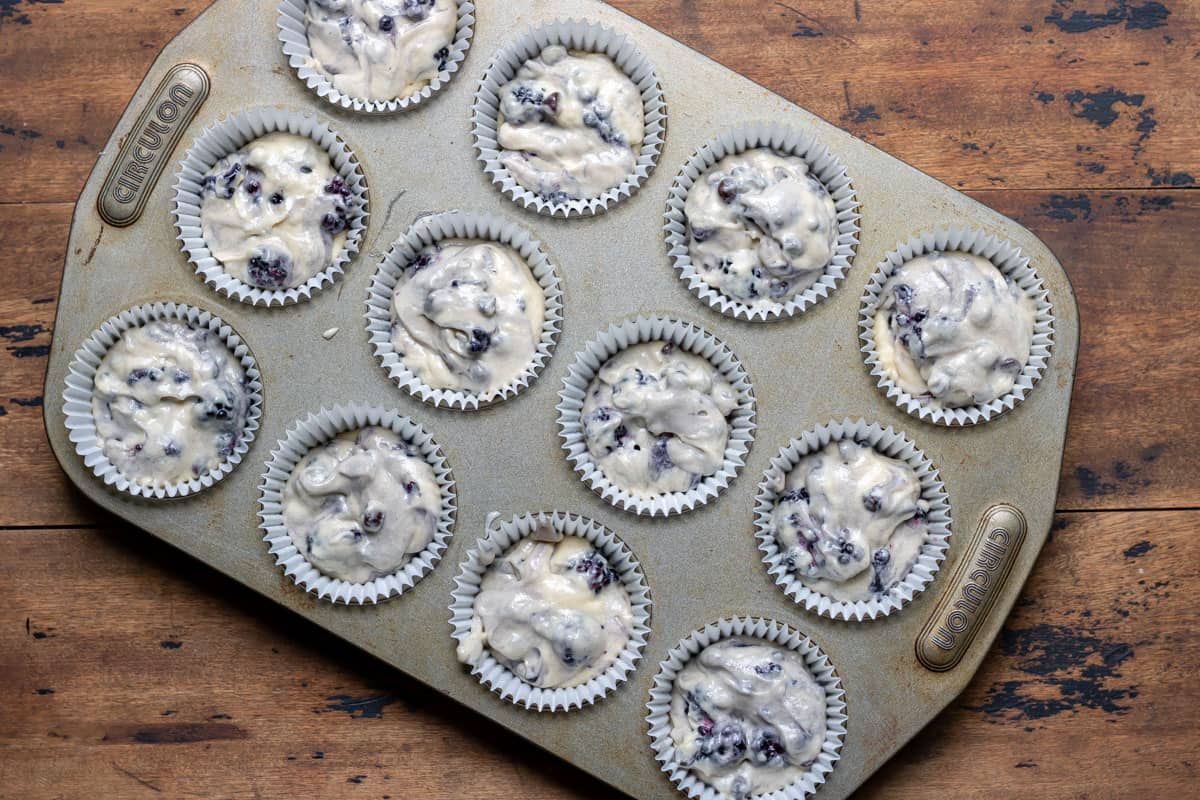 Muffin batter in a tray.