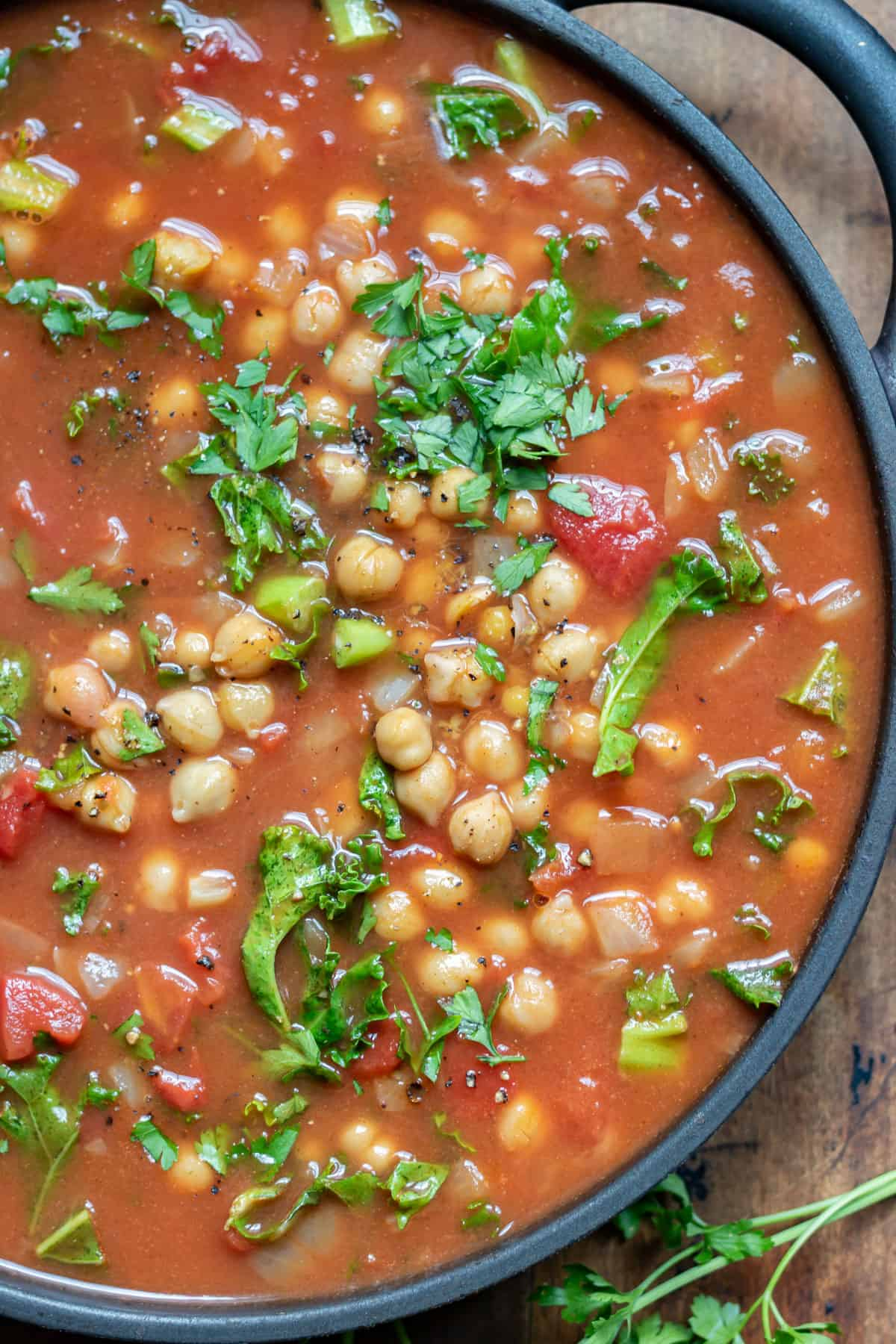 Close up of chickpea soup in a dish.