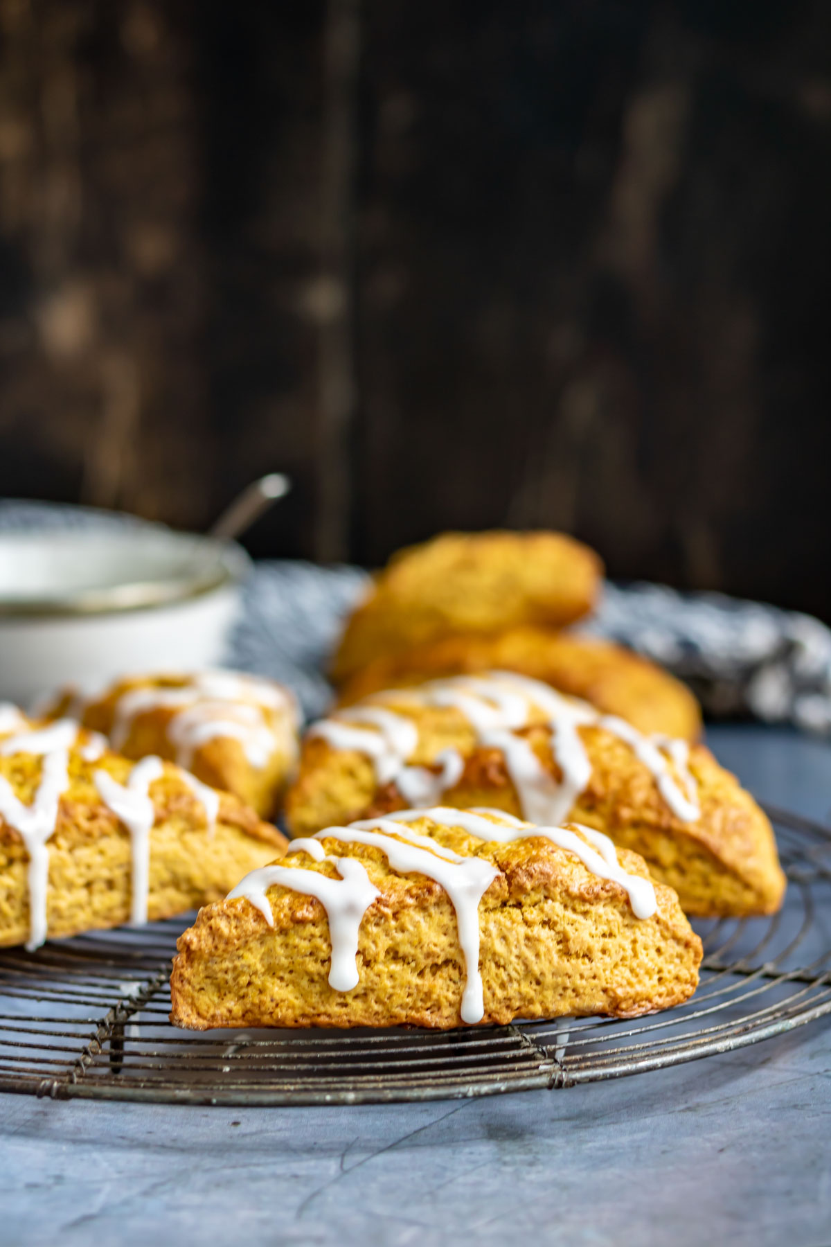 Close up of a pumpkin scone on a wire rack.