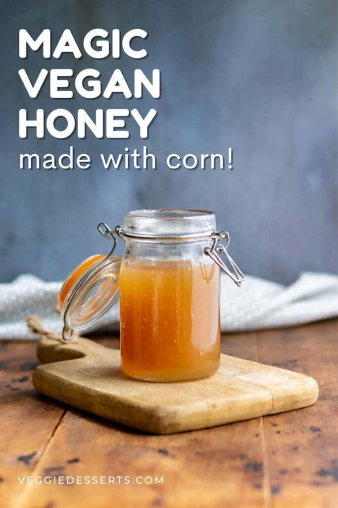 Jar on a table, with text: Magic Vegan Honey made with corn.