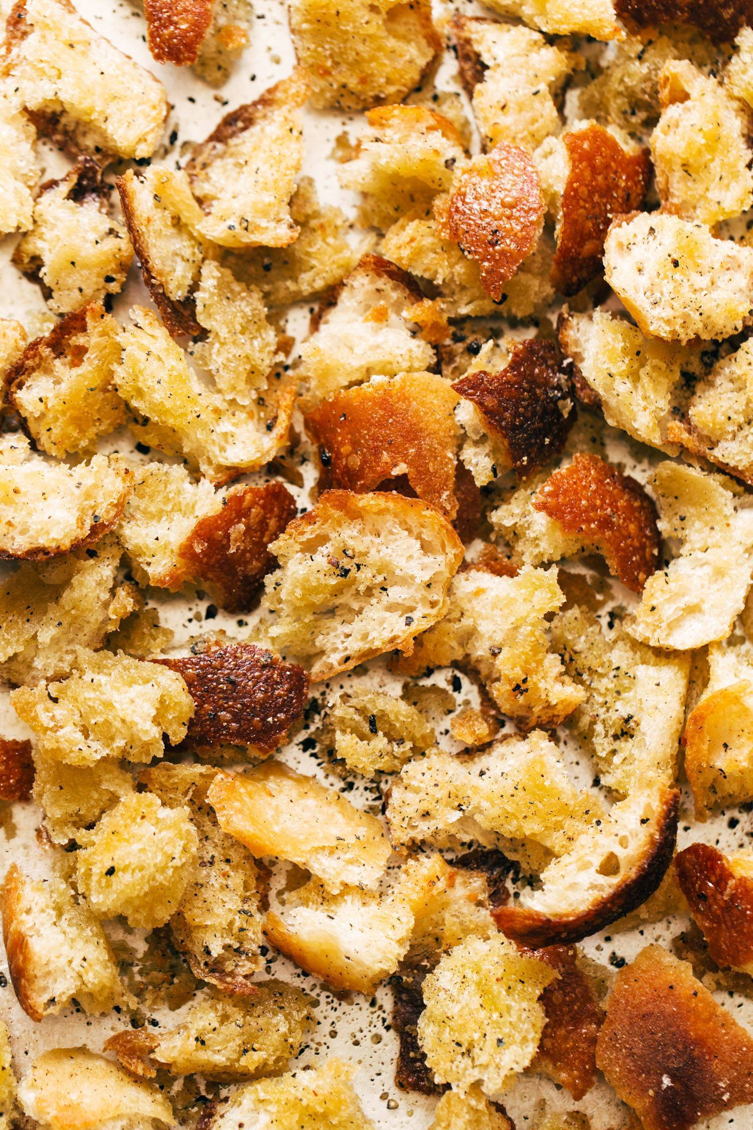 Peppery hand-torn croutons on a sheet pan.