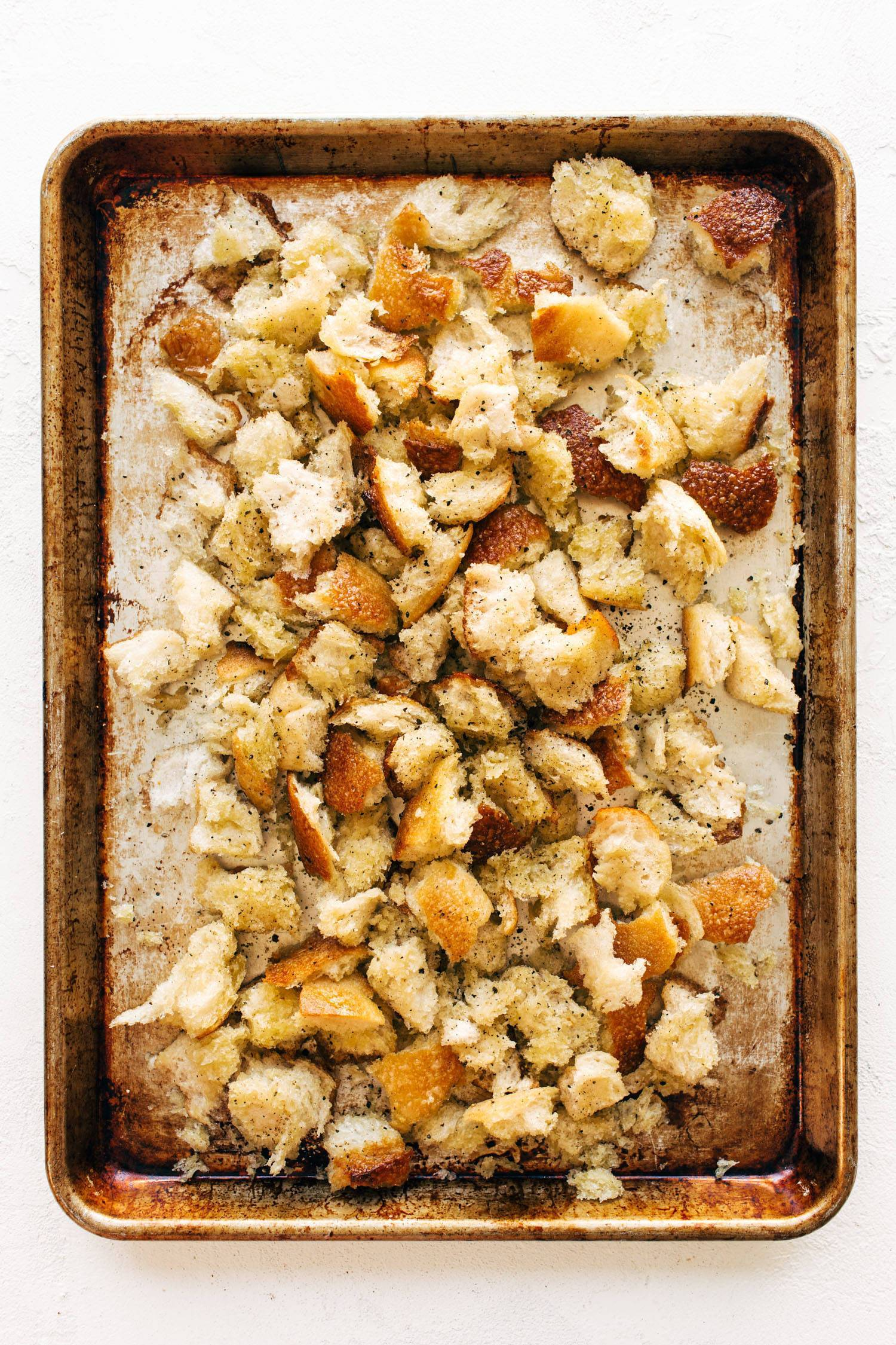 Peppery torn croutons on a sheet pan.