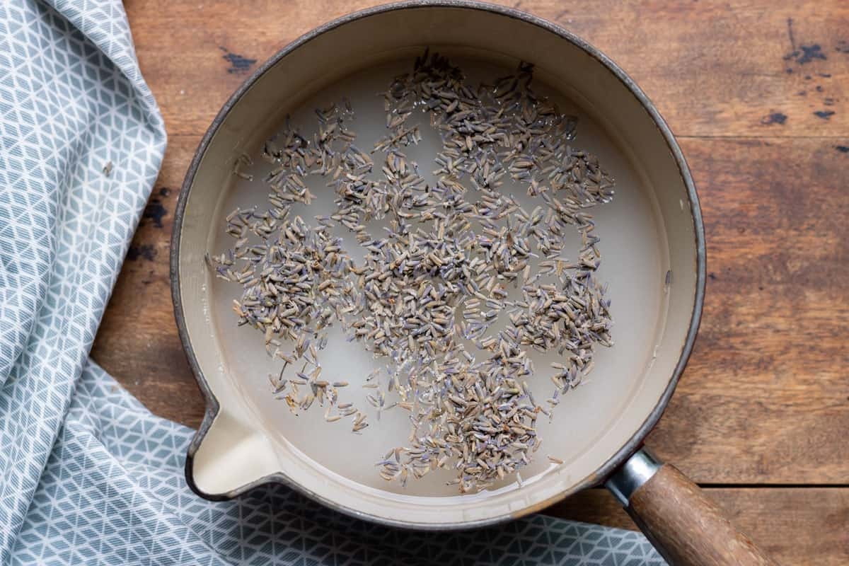 Pot with water, sugar and lavender buds.